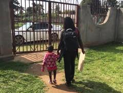 ur Senior Social Worker, Evelyn Nanteza and Hope leaving the SAM care centre