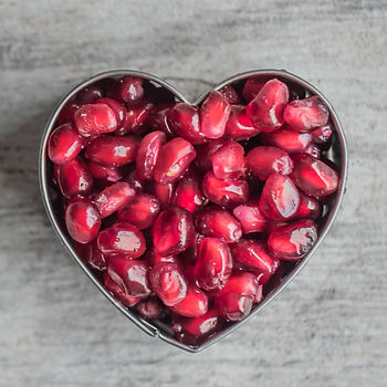 silver-heart-bowl-filled-of-red-pomegran