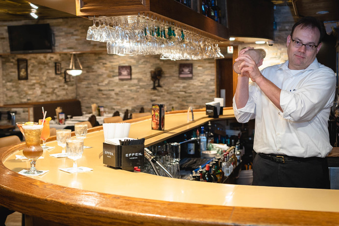 """Our vary own bartender making a """"Hard Living"""""""