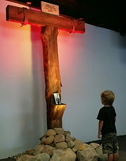 Boy gazing up at the Crossroads Chapel C
