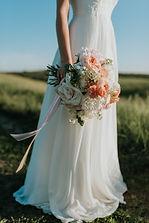 woman-wearing-white-wedding-dress-holdin