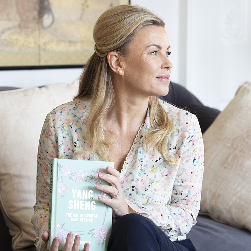 """Katie Brindle with her book """"Yang Sheng: the Art of  ChineseSelf Healing"""""""