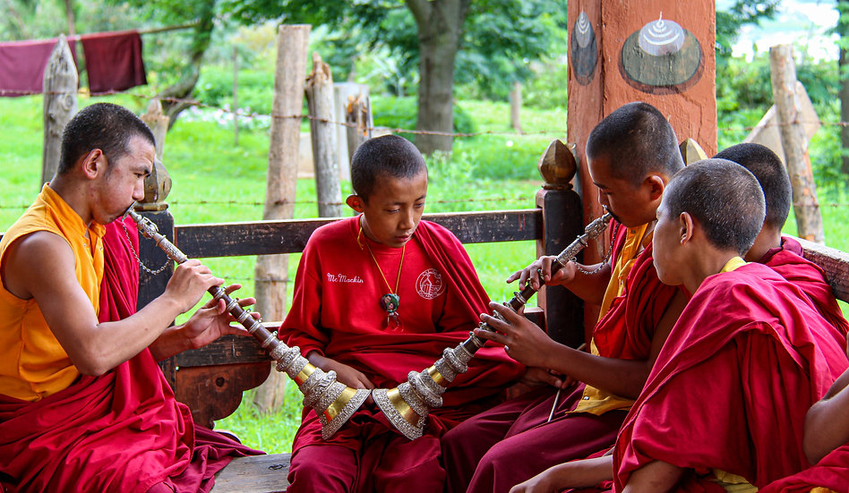 Monks Playing the Tibetan Horn