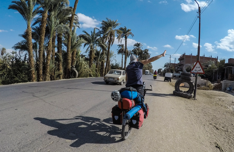 Waving back to locals in Egypt.