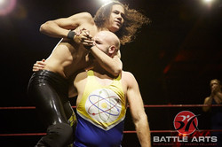 14 DARIUS ANHILE IN TAG TEAM ACTION HAS A HEADLOCK ON SCIENCE