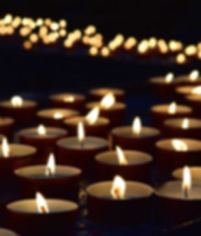 burning memorial candles on the dark bac