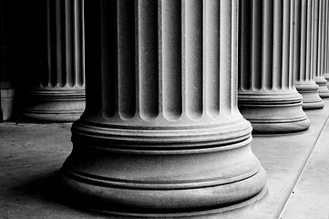 close-up of classic columns in black and