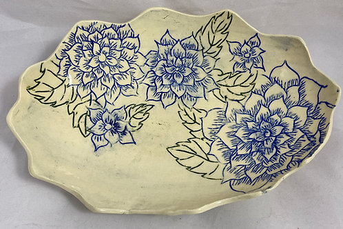 Scraffito dish with blue flower