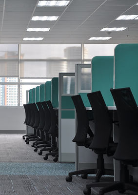empty black rolling chairs at cubicles_edited.jpg