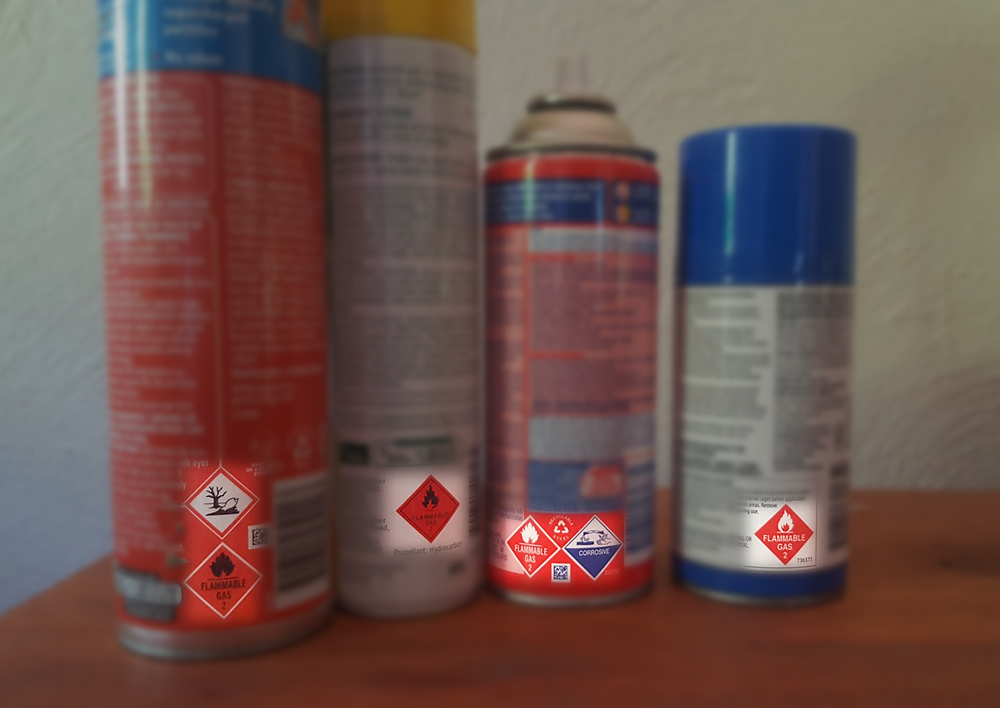 Aerosol cans with the class diamonds highlighted