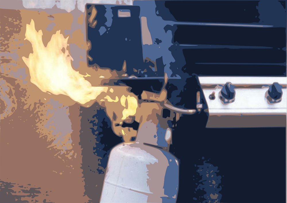 An LPG cylinder attached to a barbecue is burning