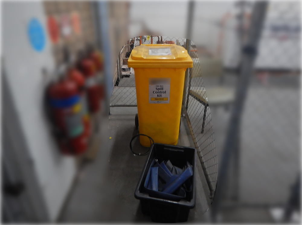 A crate is kept in front of the spill kit blocking access