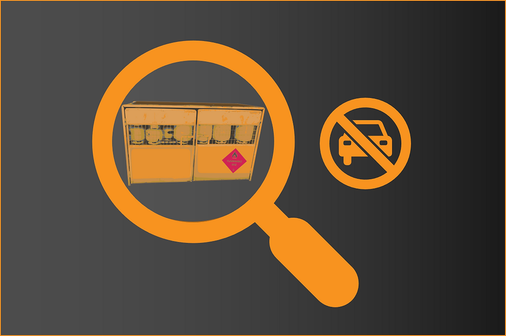 An LPG exchange cage is inside a yellow magnifying glass with a no cars symbol next to it
