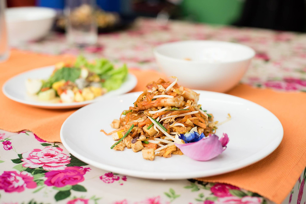 Pad thai made with edible flowers at The Market Experience by Expique in Pak Khlong Talat flower market in Bangkok, Thailand - photo by The Market Experience by Expique