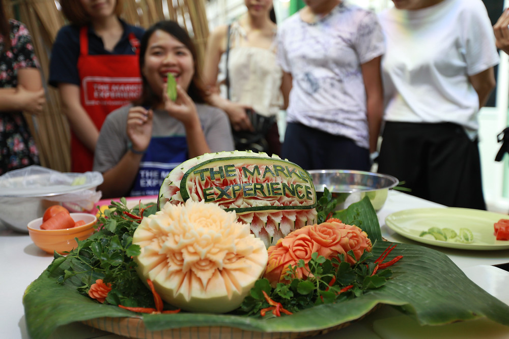 Elaborate carving on a watermelon and other fruits and vegetables - photo by The Market Experience