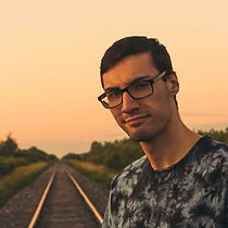 Head shot of our photographer and writer Mikey Jablonski.