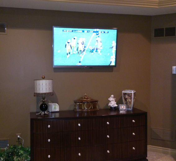 LG Bedroom TV above drawers.png