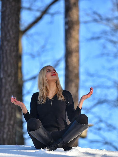 Blonde woman meditating on snow. Zen, ba