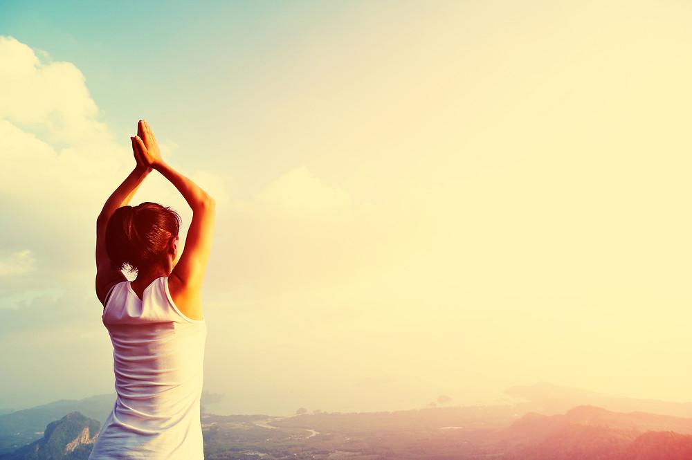 yoga woman mountain peak.jpg
