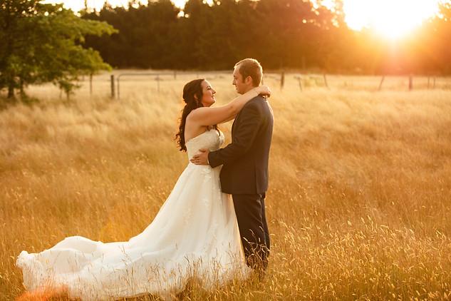 Bride and groom in golden hour photo