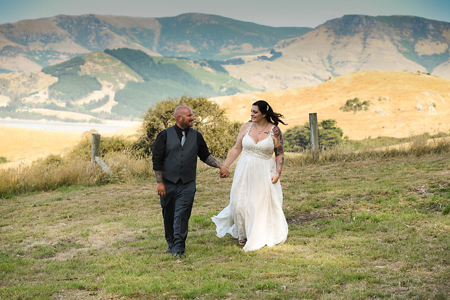 Bride and groom with mountain backdrop