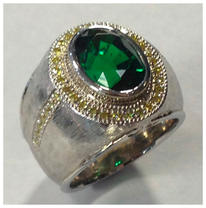 6ct tsavorite in platinum with natural y