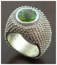 5ct peridot ring in 14 K white with diam