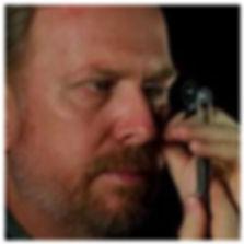 Michael examining a gem