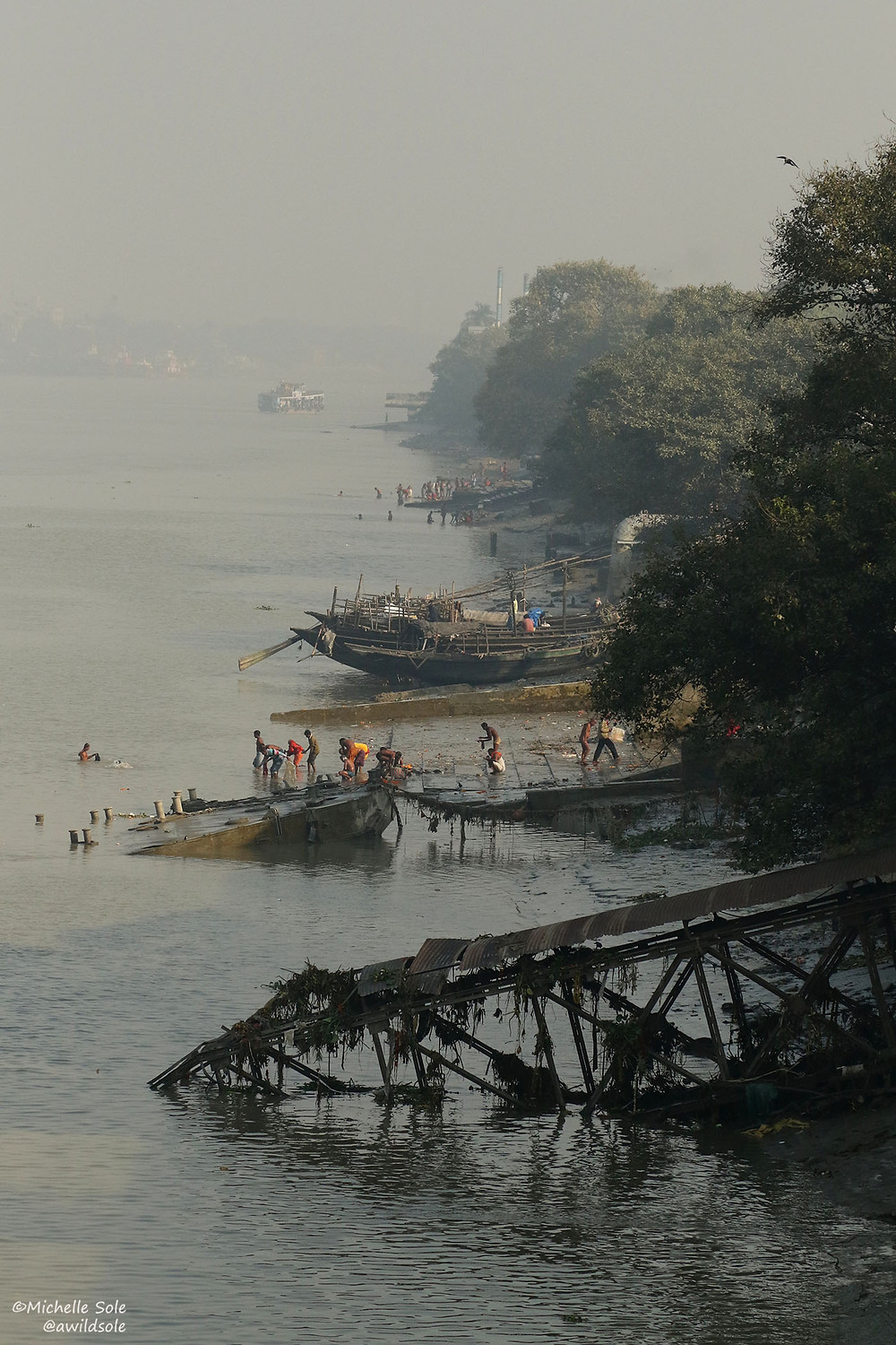 People swimming in the river in Calcutta, India