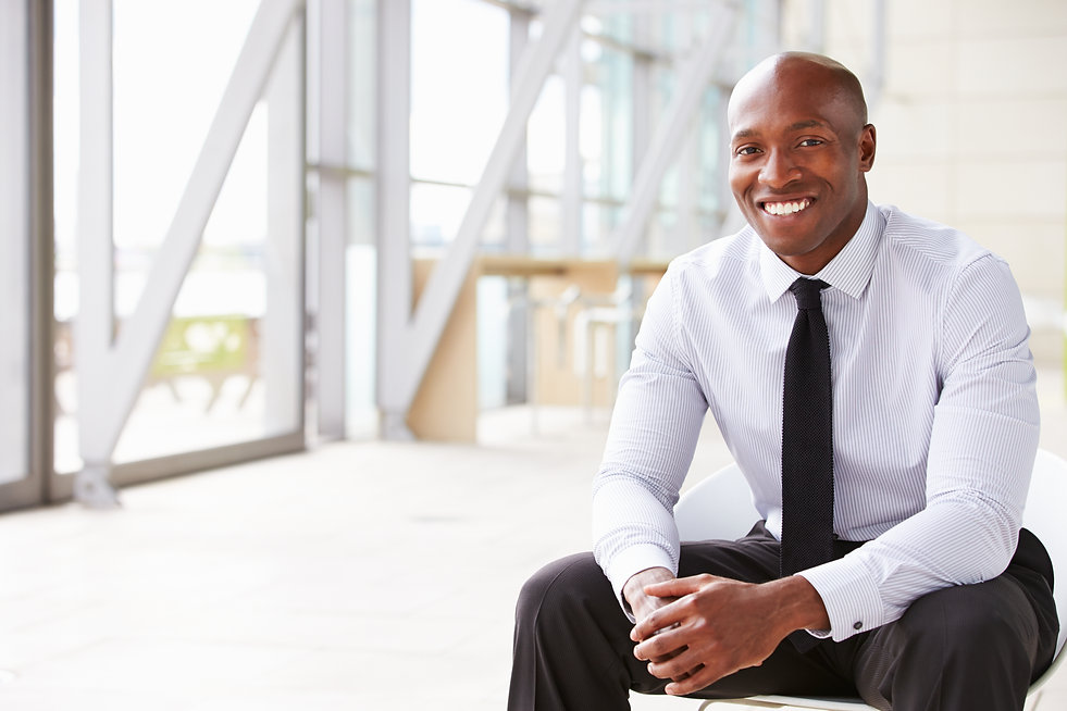 Smiling African American businessman, ho