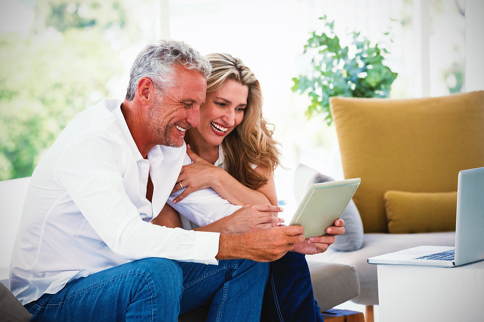 Smart mature couple using digital tablet