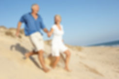 Senior Couple Enjoying Beach Holiday Run