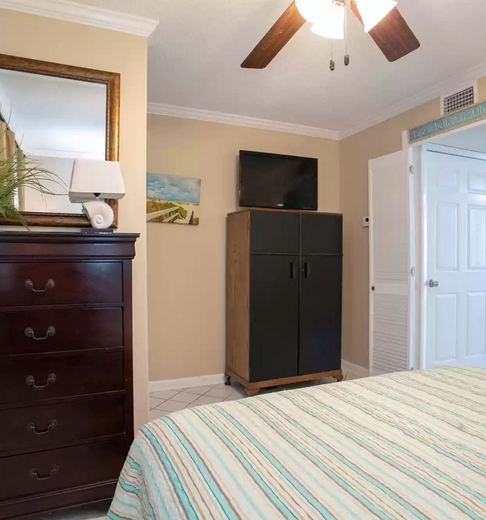 Bedroom with plenty of storage and flat screen tv