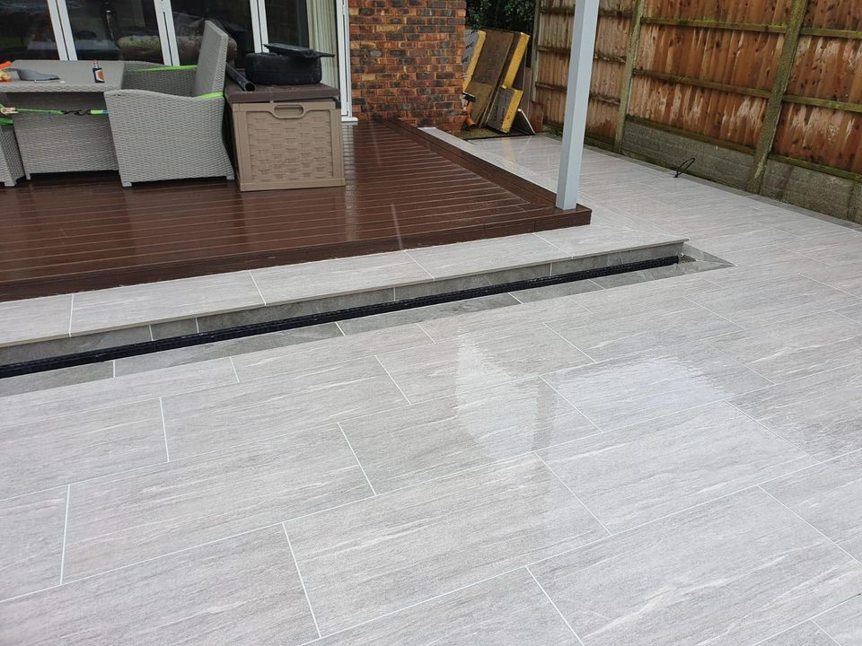 Vals Grigio patio porcelain paving, the perfect outdoor living and entertainment space.