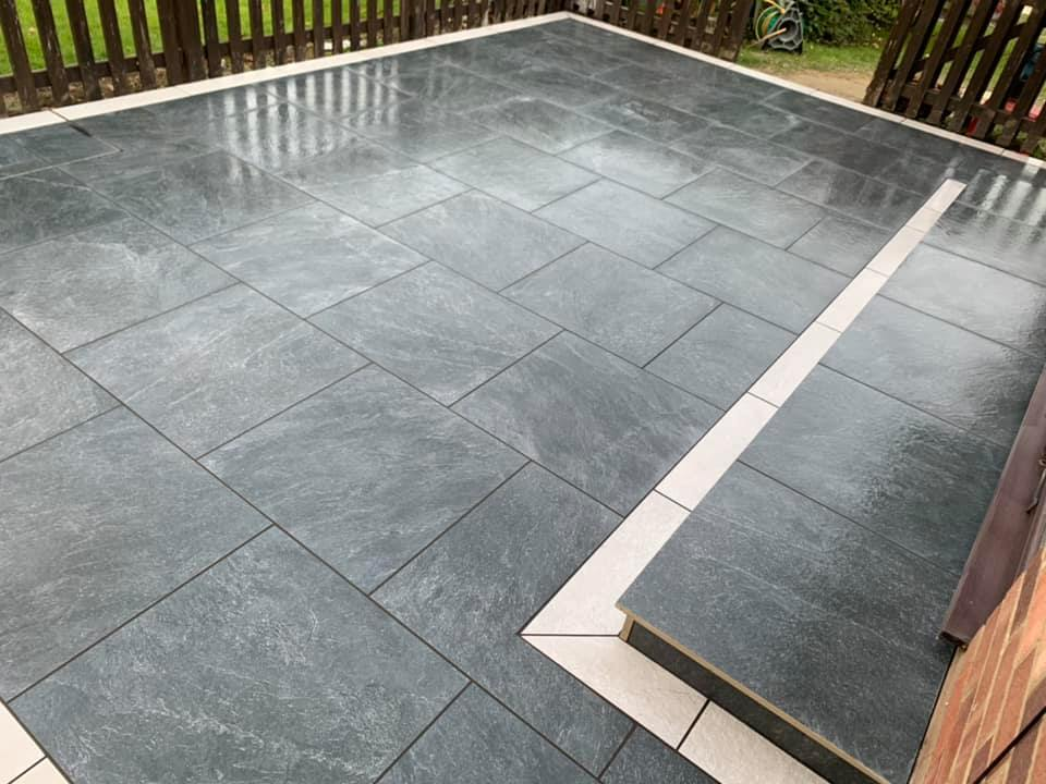 Simple yet dramatic VT Black with VT Grey border front patio.