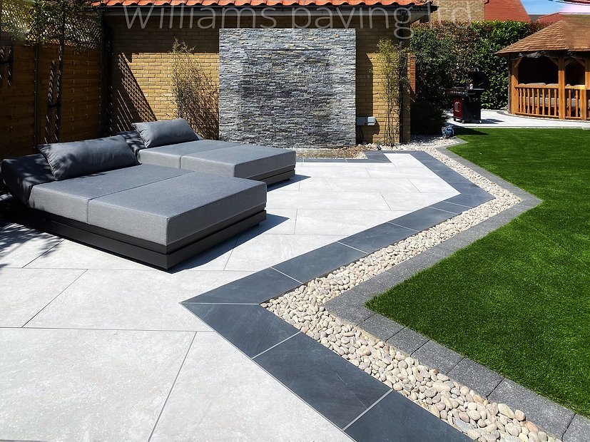 Beautiful procelain patio paving tiles in light grey with a black border