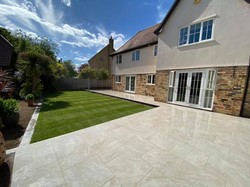 Light coloured porcelain tiles for this large outdoor space, giving the perfect look to this back ga