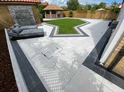 An outdoor living space and entertain areas transformed with water features, porcelain patio tiles a