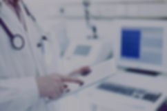 Doctor Using Digital Tablet_edited_edite