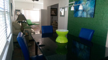New Tiki cottage furniture and glass mosaic accent wall! New blue chairs to add to the granite table