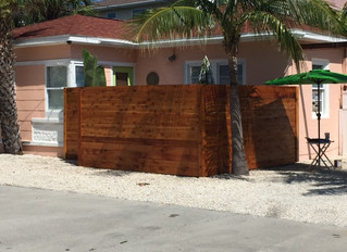 Beautiful new cedar fencing at Sunset and Tiki cottages.