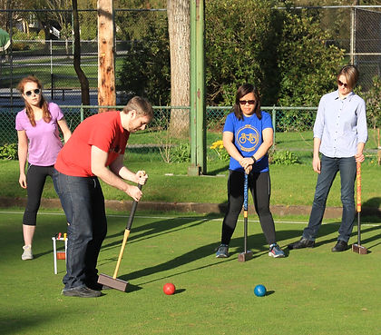 A group of young men and women enjoy a gameof croquet at the Dunbar Lawn Bowling Club