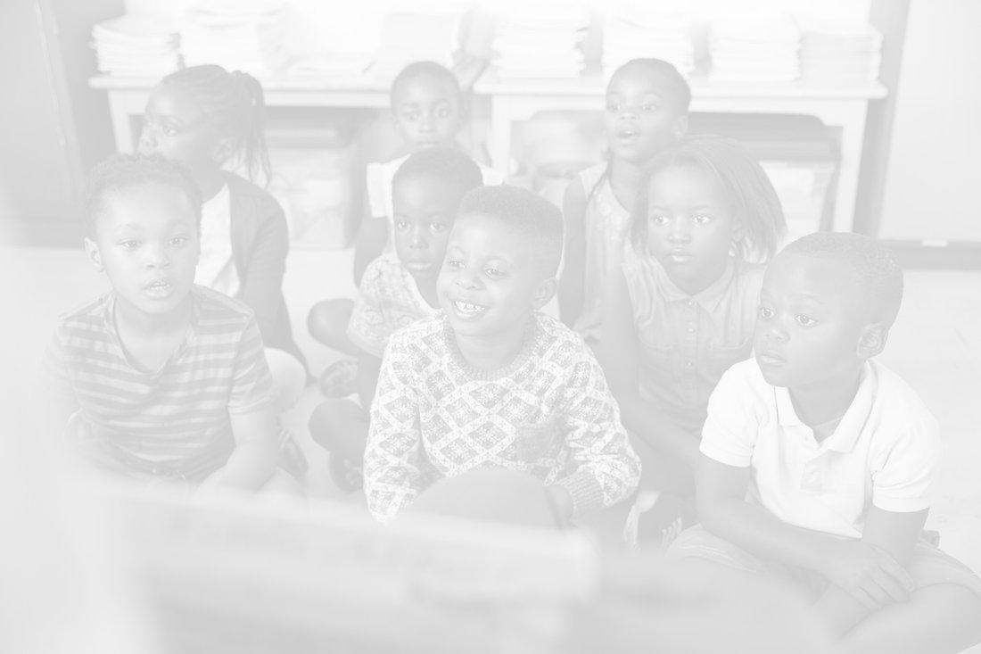 Teacher reading book to elementary school children in class_edited.jpg