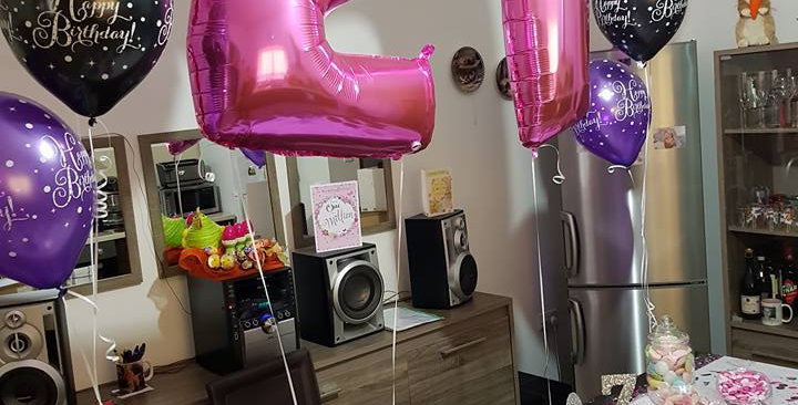 34'' foil balloon inflated with helium including ribbon