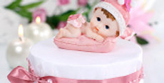 Figurines Boy or Girl with a blue or pink pillow, height 8.5 centimeters.