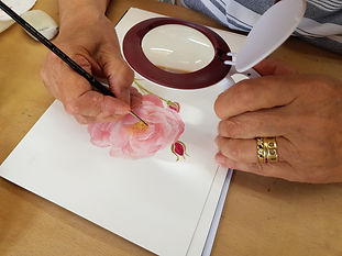 Student Sheila painting a rose
