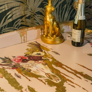 Skull and flowers painted gold leaf drin