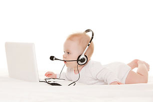 Cute baby-operator with laptop on the wh