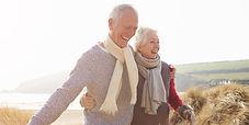 Senior-Couple-Walking-Through-Sand-Dunes