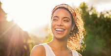 Young-african-woman-smiling-at-sunset.jp